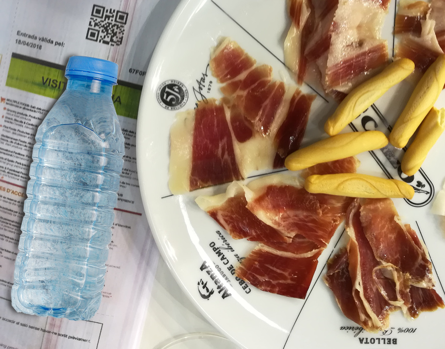 Slices of pata negra ham and a bottle of water