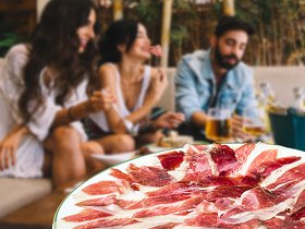 Eating sliced bellota ham with some friends